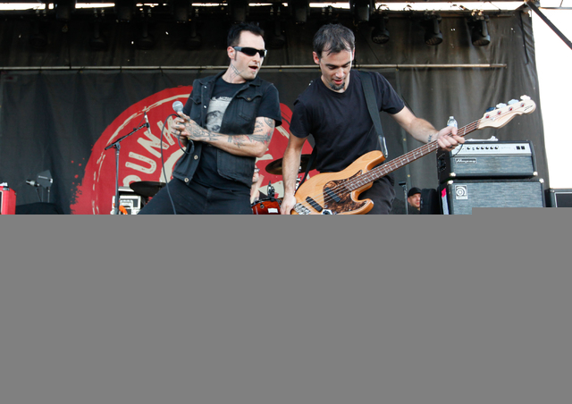 Scott Sturgeon, known as Stza, left, and Alec Baillie of Leftover Crack perform at the Punk Rock Bowling music festival in downtown Las Vegas on Monday, May 26, 2014. (Chase Stevens/Las Vegas Revi ...