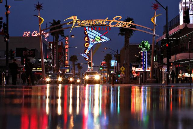 The lights of Fremont East reflect off of wet ground during a light rain in Las Vegas Thursday, Feb. 6, 2014. (John Locher/Las Vegas Review-Journal)