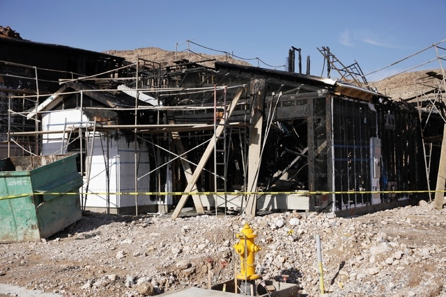 Fire damage is seen on homes under construction near Fort Apache Road and Warm Springs Road in Las Vegas Thursday, May 8, 2014. (John Locher/Las Vegas Review-Journal)
