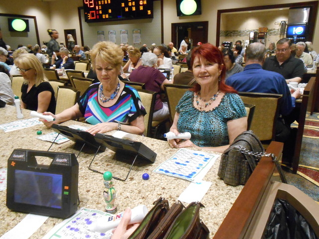 Barbara Selph, left, and Olive Turney play bingo April 18 at the Rampart Casino, 221 N. Rampart Blvd. The very next number was a winner, and Turney called a monitor to verify her card. She won $50 ...