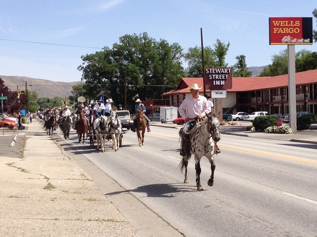 Elko County rancher Grant Gerber leads ranchers on horseback into Carson City on Friday, May 30, 2014. The group rode to the state Capitol to present Gov. Brian Sandoval with a petition calling at ...