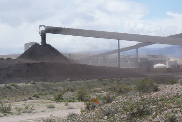 Ash blows from the coal waste pile of the NV Energy Reid Gardner power station, shown in this courtesy photo dated Jan. 5, 2010. NV Energy south is proposing to close three of its four Reid Gardne ...