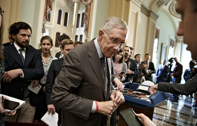 Senate Majority Leader Harry Reid, D-Nev., speaks to reporters after a Democratic caucus lunch, at the Capitol in Washington, Tuesday, May 6, 2014. (AP Photo/J. Scott Applewhite)