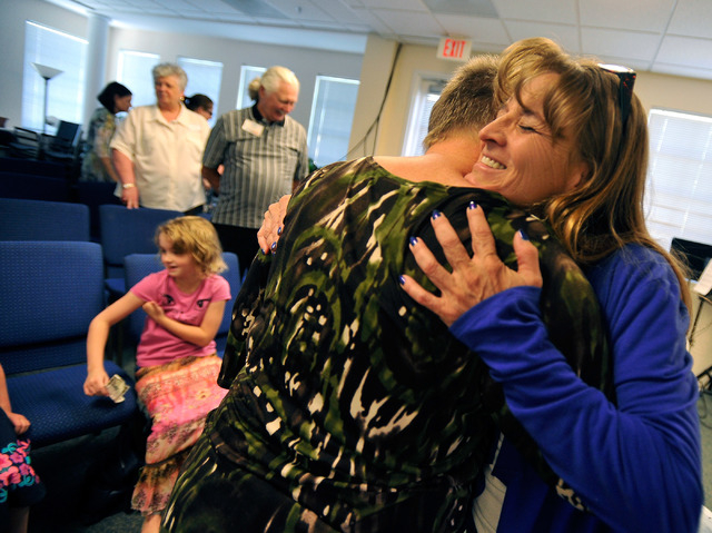Deidre Buus, right, embraces Ann Sanders during the worship service at Unity Center in the Valley on Sunday, May 11, 2014. The weekly service features music, a spiritual lesson and meditation. (Da ...