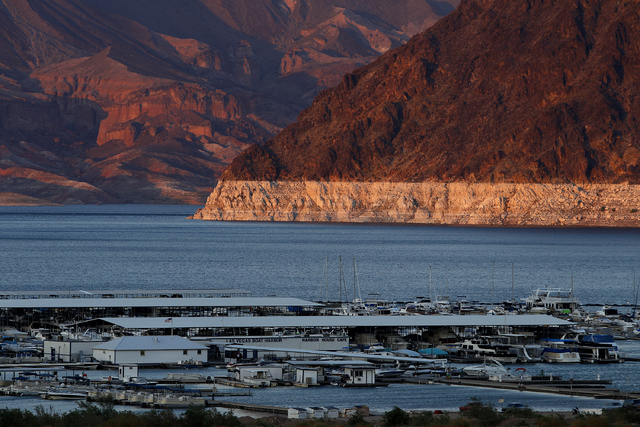 """The 'bathtub ring"""" is seen behind Hemenway Harbor on Lake Mead in Nevada Tuesday, Aug. 7, 2013. The ring shows the previous lake levels. (John Locher/Las Vegas Review-Journal)"""