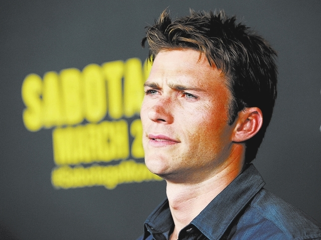 """Actor Scott Eastwood poses at the premiere of the film """"Sabotage"""" on Wednesday, March 19, 2014 in Los Angeles. (Photo by Chris Pizzello/Invision/AP)"""