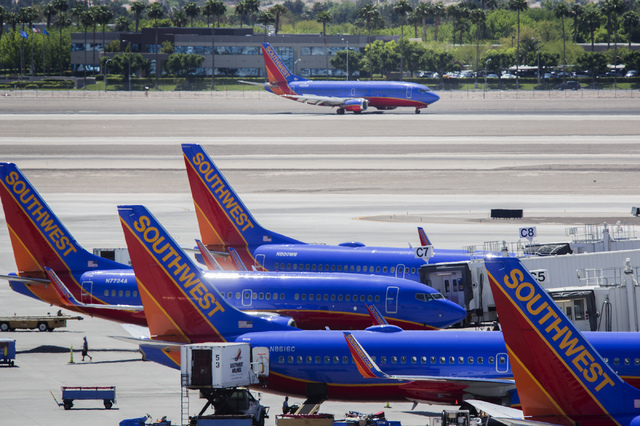 Southwest Airlines planes as seen Thursday, April 24, 2014 at McCarran International Airport. The Dallas-based air carrier reported net income of $152 million, 22 cents per share, on revenue of $4 ...