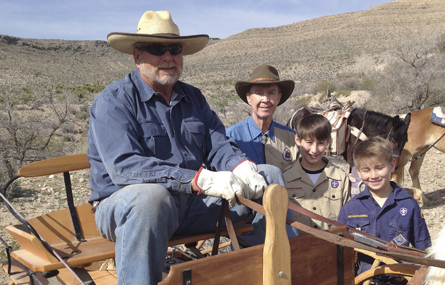 Jim Sage, from left, poses with the Old Spanish Trail Association's national president, Ashley Hall, and Hall's grandsons, Jay Dominguez, 11, and Deivy Dominguez, 9, before they set out March 29 t ...