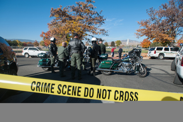Police secure the scene near Sparks Middle School after a shooting in Sparks, Nev., on Monday, Oct. 21, 2013. Authorities are reporting that two people were killed and two wounded at the Nevada mi ...