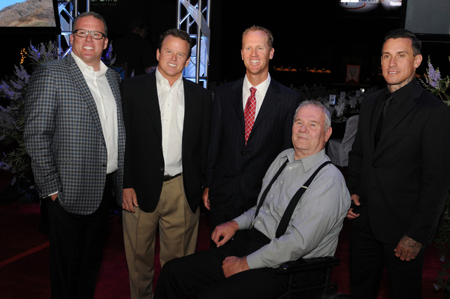 Members of the 2014 class of the Southern Nevada Sports Hall of Fame, from left, Troy Herbst and his brother Tim, desert racing champions, Chris Riley, professional golfer from UNLV, Ken Black, dr ...