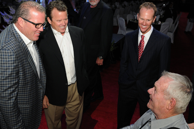 Members of the 2014 class of the Southern Nevada Sports Hall of Fame, from left, Troy Herbst and his brother Tim, desert racing champions, Chris Riley, professional golfer from UNLV, and Ken Black ...