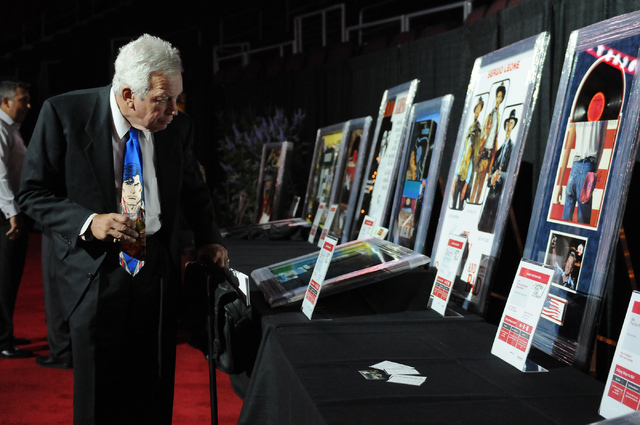 Jim Callaway browses silent auction items during the 2014 class of the Southern Nevada Sports Hall of Fame induction ceremony at the Orleans Arena in Las Vegas Friday, May 30, 2014. (Erik Verduzco ...