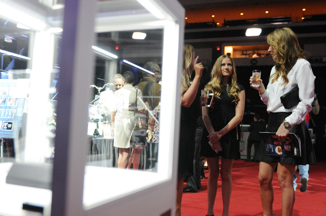 Laura Herbst, from right, her daughter Shelby and friend Kaila Tuvell, mingle during the 2014 class of the Southern Nevada Sports Hall of Fame induction ceremony at the Orleans Arena in Las Vegas  ...