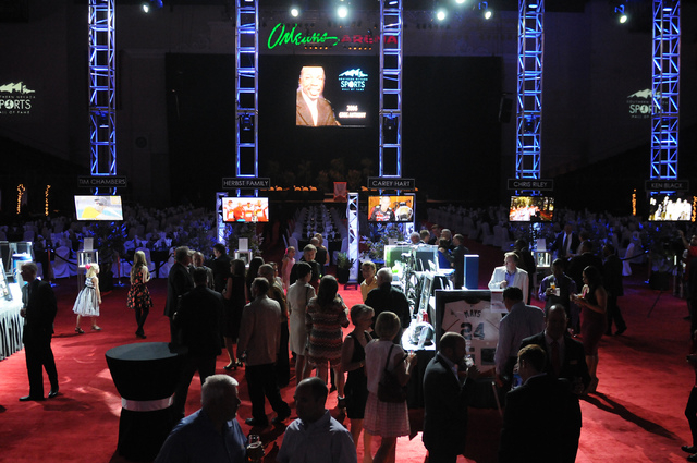 Attendees mingle during the 2014 class of the Southern Nevada Sports Hall of Fame induction ceremony at the Orleans Arena in Las Vegas Friday, May 30, 2014. (Erik Verduzco/Las Vegas Review-Journal)