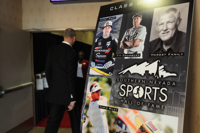 A sign displays the portraits of the 2014 class of the Southern Nevada Sports Hall of Fame during the induction ceremony at the Orleans Arena in Las Vegas Friday, May 30, 2014. (Erik Verduzco/Las  ...