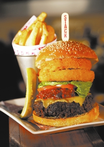 Kobe Stacked Burger at Stack Restaurant and Bar, The Mirage: Ten ounces of Kobe beef get even more flavor from a crispy onion ring, Vermont cheddar and special sauce; it's served with fries.  (C ...