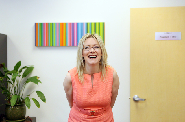 Florence Rogers, president and CEO of KNPR Nevada Public Radio, laughs in her office at Donald W. Reynolds Broadcast Center Friday, May 16, 2014, in Las Vegas. Rogers fed seals and sold tickets wh ...