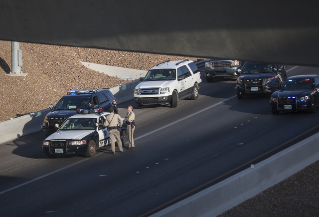 Law enforcement officers investigate a suicide  on Summerlin Parkway near U.S. 95  on Tuesday, May 6, 2014. Nevada Highway Patrol responded just before 5:30 a.m. to a woman who jumped from the Sum ...