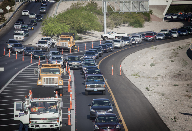 Eastbound traffic backs up on Summerlin Parkway near U.S. 95  on Tuesday, May 6, 2014. Nevada Highway Patrol responded just before 5:30 a.m. to a woman who jumped from the Summerlin Parkway overpa ...