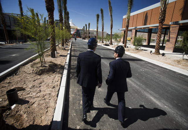 Howard Hughes Corporation executives Grant Herlitz, president, left, and David Weinreb, CEO, walk Downtown Summerlin  at Sahara Avenue and I-215 on Thursday, May 15, 2014. The first phase of the d ...