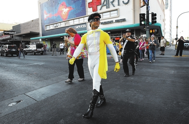 The Crosswalk Crusader leads a flash mob across Fremont Street during an event aimed to increase driver awareness for pedestrians in Las Vegas on Thursday. (Jason Bean/Las Vegas Review-Journal)