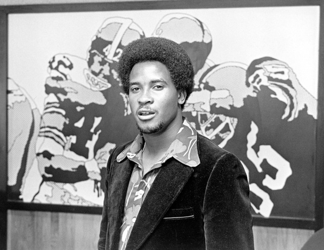 Lynn Swann, the Pittsburgh Steelers number one draft choice, stands before a large graphic display at Three Rivers Stadium after signing with the NFL team, April 18, 1974.  (AP Photo/Harry Cabluck)