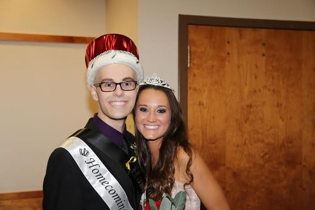 Homecoming King Michael Tatalovich, a cancer survivor, poses with Homecoming Queen Logan Lucas on October 12, 2013. (courtesy Michael Tatalovich)