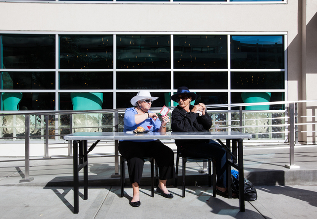 Emma Gray, right, and Linda Bocchino, eat outside of Downtown Grand after the inauguration of a new exhibition dedicated to former Las Vegas sheriff Ralph Lamb as part of a National Tourism Week R ...