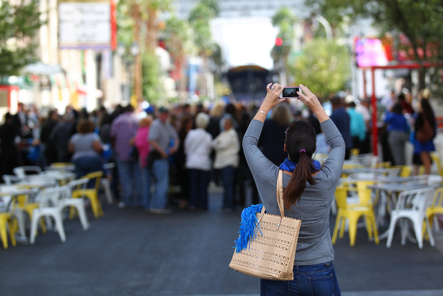 Marci Bylund takes a photo as tourism supporters eat and mingle outside of the Downtown Grand after the inauguration of a new exhibition dedicated to former Las Vegas sheriff Ralph Lamb as part of ...