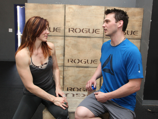 Trainer Chris Huth, right, and Laura Salcedo, left, discuss proper snacks to eat after a workout at CrossFit Mountain's Edge in Las Vegas on Tuesday, April 22, 2014. (Justin Yurkanin/Las Vegas Rev ...