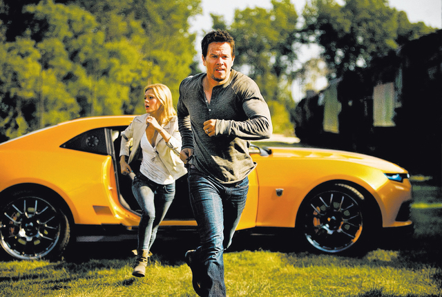Left to right: Nicola Peltz plays Tessa and Mark Wahlberg plays Cade Yeager in TRANSFORMERS: AGE OF EXTINCTION, from Paramount Pictures.