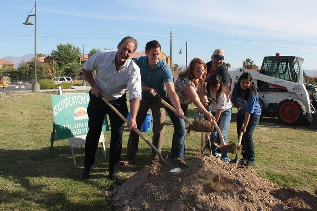 North Las Vegas Mayor John J. Lee, from left, Friends of Craig Ranch President Jon Oats, Assembly Speaker Marilyn Kirkpatrick and park volunteers plant some new trees at Craig Ranch Regional Park, ...