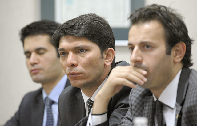 Judges Yayla Soner, from left, Judge Bulent Agkoc, and public prosecutor Yusuf Ziya Polater listen to discussion at a Review-Journal editorial board meeting on Friday, May 2, 2014. They are part o ...