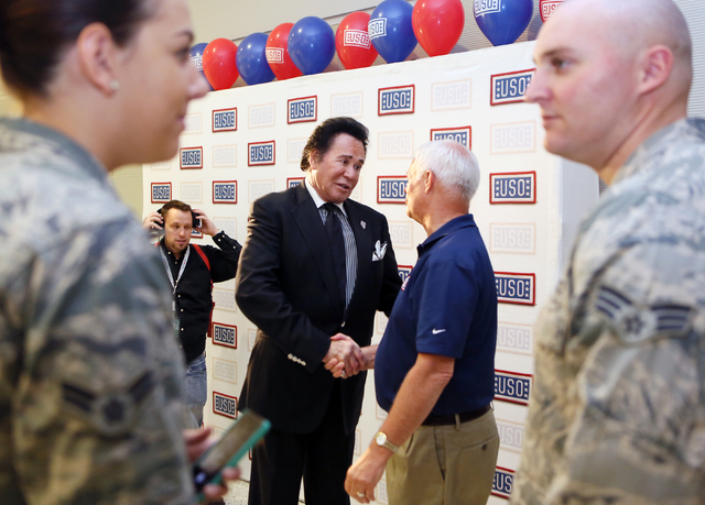Entertainer Wayne Newton, center left, shakes hands with Al Kaste, USO area director, during the grand opening of McCarran International Airport's Terminal 3 USO canteen Wednesday, May 7, 2014, in ...