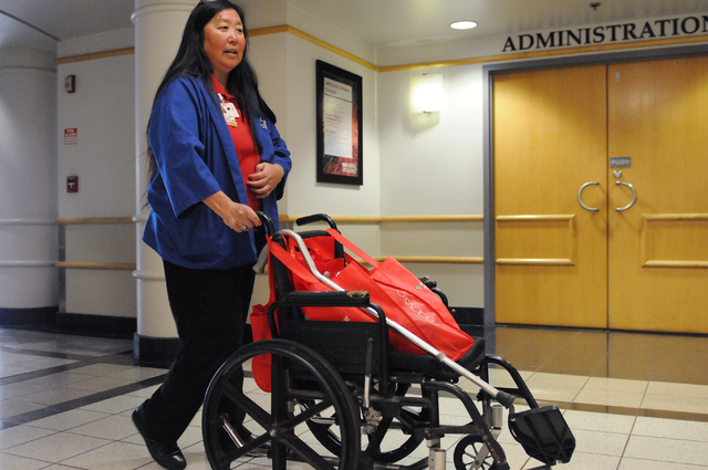Volunteer Lori Wright walks the hallways at Valley Hospital Medical Center in Las Vegas Wednesday, April 23, 2014. Wright roams patient's rooms to share information about the American Heart Associ ...