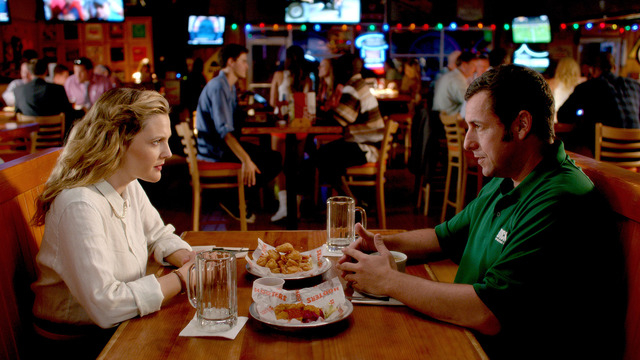 "Jim (Adam Sandler) wears his Dick's Sporting Goods work shirt on a blind date at Hooters wirh Lauren (Drew Barrymore) in a scene from the comedy ""Blended."" (Courtesy of Warner Bros. Pict ..."