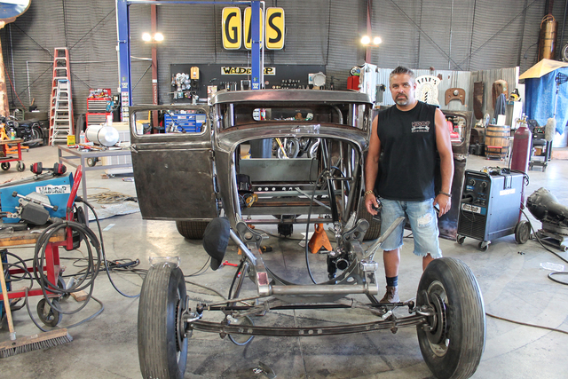 Steve Darnell standing by the 1931 Ford Model A 5 he is building for his brother. (Courtesy Discovery Channel)