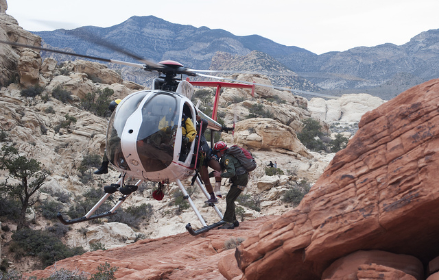 Members of the Las Vegas Metro Police Search and Rescue Unit load an injured girl onto a rescue helicopter in this file photo. The search and rescue team conducted four missions during Memorial Da ...
