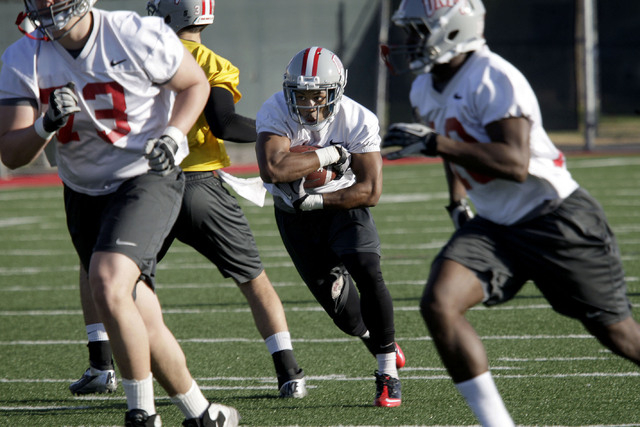 UNLV football running back Adonis Smith, center, is seen during the first day of spring practice on campus at UNLV in Las Vegas Monday, Mar. 4, 2013. (Jessica Ebelhar/Las Vegas Review-Journal)