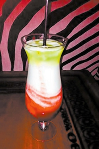 With La Bandera at Cabo Wabo Cantina, Miracle Mile Shops, the colors of the Mexican flag are commemorated in a 24-ounce daiquiri. (Courtesy)