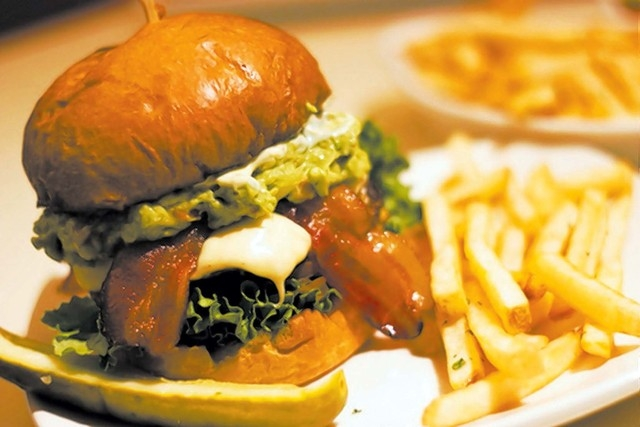 The Guacamole burger at I Love Burgers, Palazzo, features an Angus beef patty topped with guacamole, pepper jack cheese, bacon, habanero mayo, onion straws, lettuce and tomato and served on a brio ...