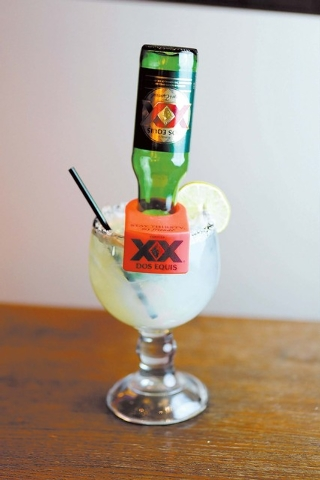 The Most Interesting Margarita in the World from The Salted Lime, Aliante, is a 20-ounce cocktail served with a 12-ounce Dos Equis lager. (Courtesy)