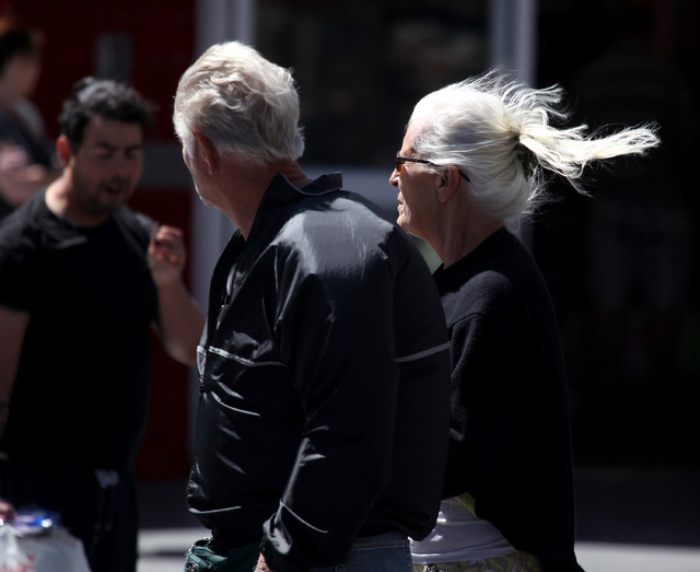 Betina Kelly, right, and Paul Kelly, left, walk down Fremont Street in downtown Las Vegas on Sunday, May 11, 2014. Firefighters are on a high alert, because a red flag warning is in effect, meanin ...
