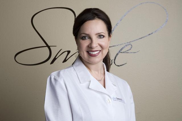 Olya Banchik poses at Hillcrest Dental at 3350 Novat St. on April 29. (Jeferson Applegate/Las Vegas Review-Journal)