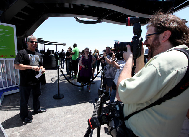 Bruce Buffer prepares for the inaugural ride on  the VooDoo Zipline from the 50th floor of the Rio in Las Vegas on Sunday, May 25, 2014. The ride is 490-feet above the ground and zips down the lin ...