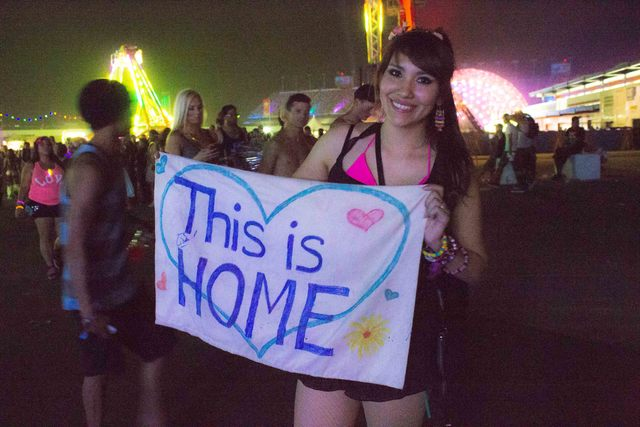 A young woman from out of town holds up a banner she created for the Electric Daisy Carnival on Saturday, June 21. (Kristen DeSilva/Las Vegas Review-Journal)