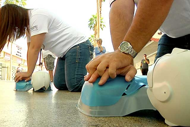 American Red Cross volunteers and firefighters from Las Vegas and North Las Vegas, performed CPR at the Fremont Street Experience as part of a flash mob to promote CPR Awareness Week.