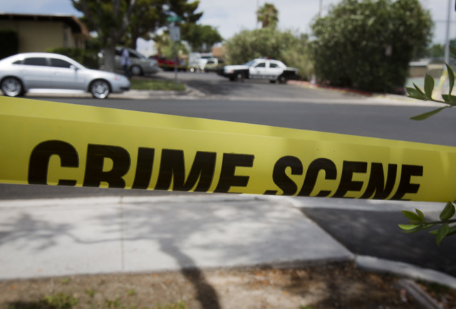 Las Vegas police on scene of shooting at 2600 block of Heritage Court, near Sahara Avenue and Mojave Road on Friday, June 20, 2014. One person died and three were wounded in a shooting Friday morn ...