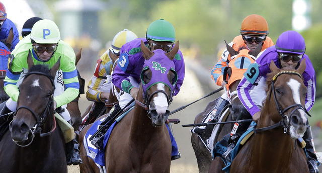 California Chrome, center, ridden by Victor Espinoza in Preakness Stakes, tries to win the Belmont Stakes on Saturday and complete the Triple Crown. (AP Photo/Patrick Semansky)