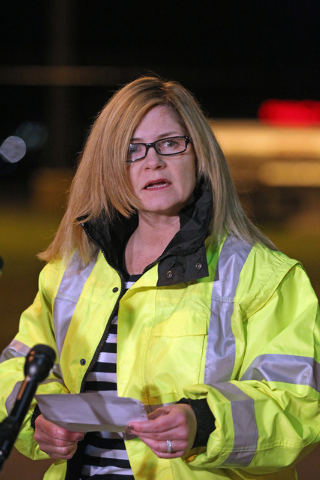 Sharon Williams, Director of Hanscom Field speaks to the media at the gate of Hanscom Field where a private Gulfstream IV plane with seven people aboard crashed and caught fire late Saturday, May  ...